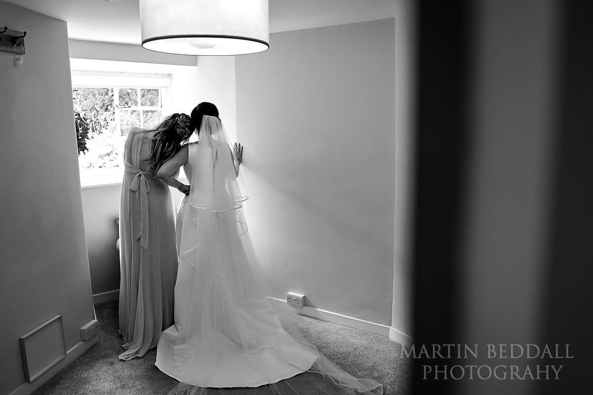 Quiet moment between the bride and her sister at Farnham Castle