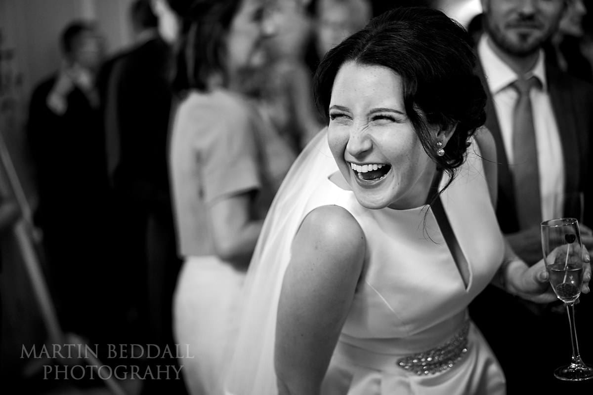 Laughing bride at Farnham Castle wedding