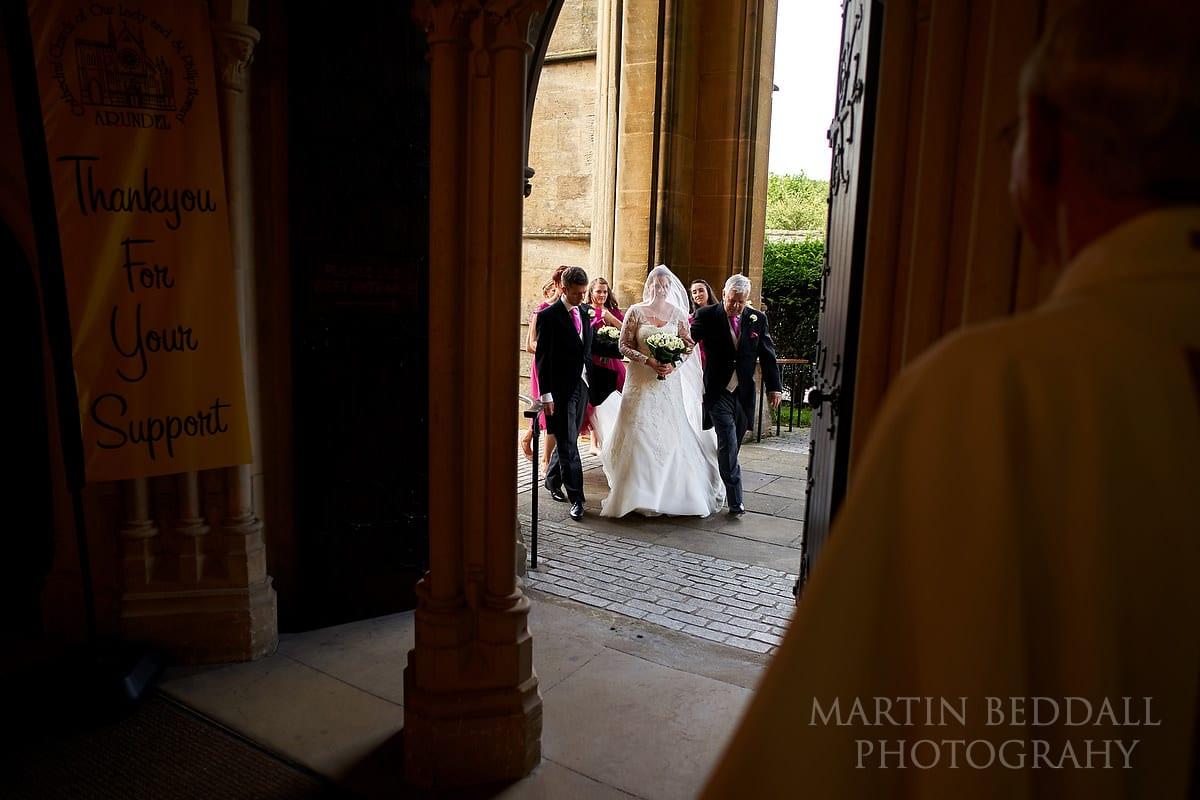 Bride escorted into Arundel Cathedral