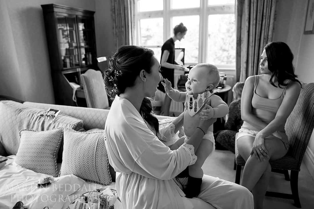 Bride playing with her son