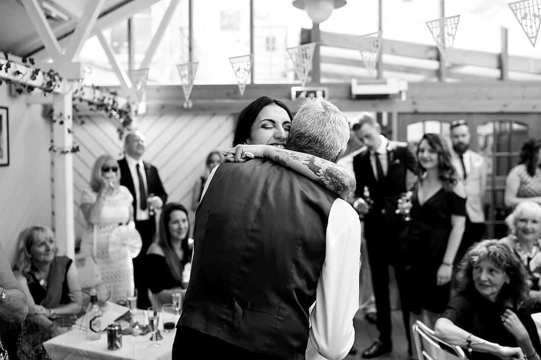 Bride hugs her father after his speech