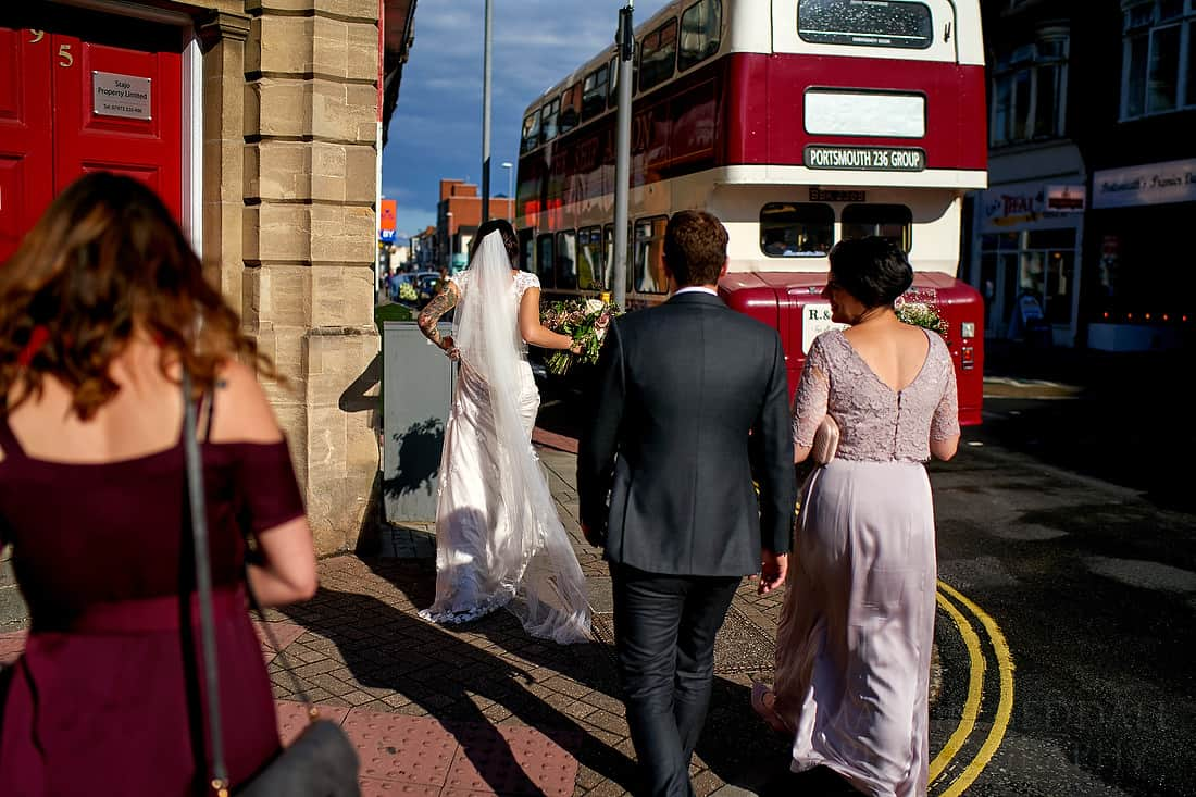 Heading to the wedding bus in the sunshine