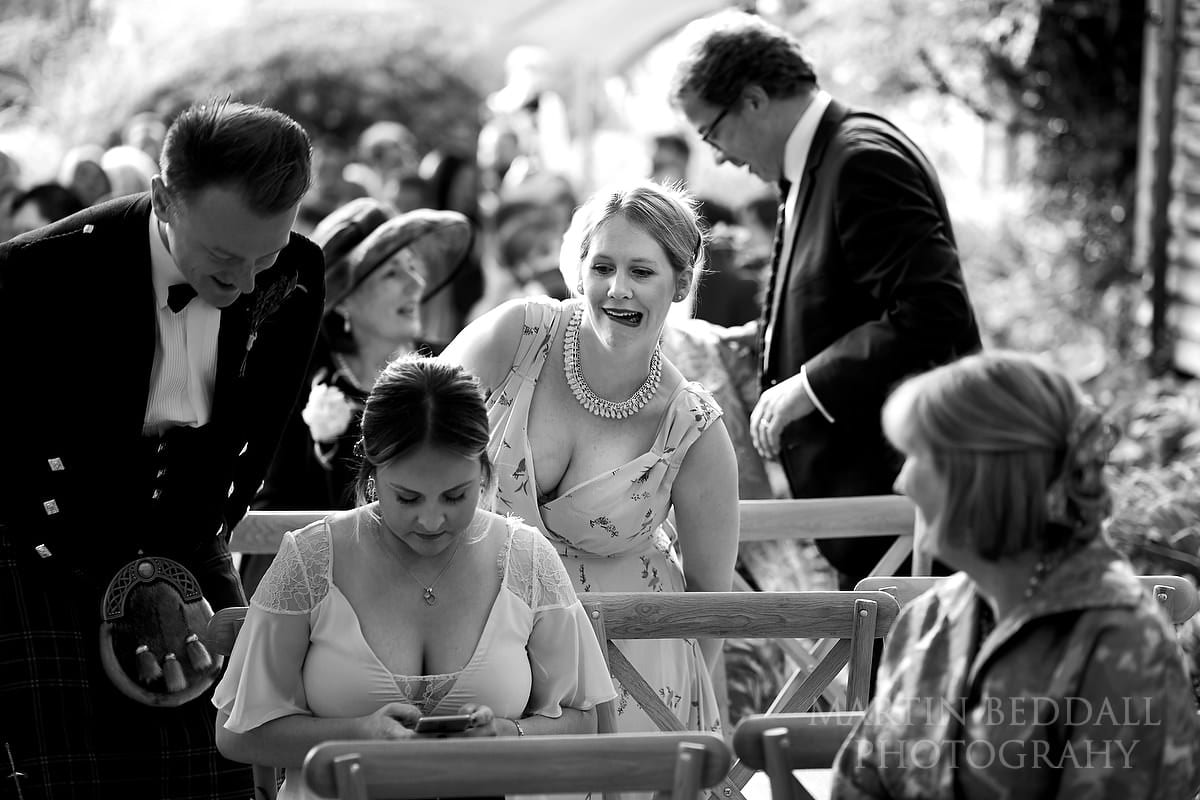 Wedding guests take their seats for the ceremony
