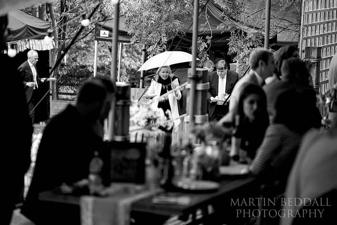 Guests getting their food in the rain