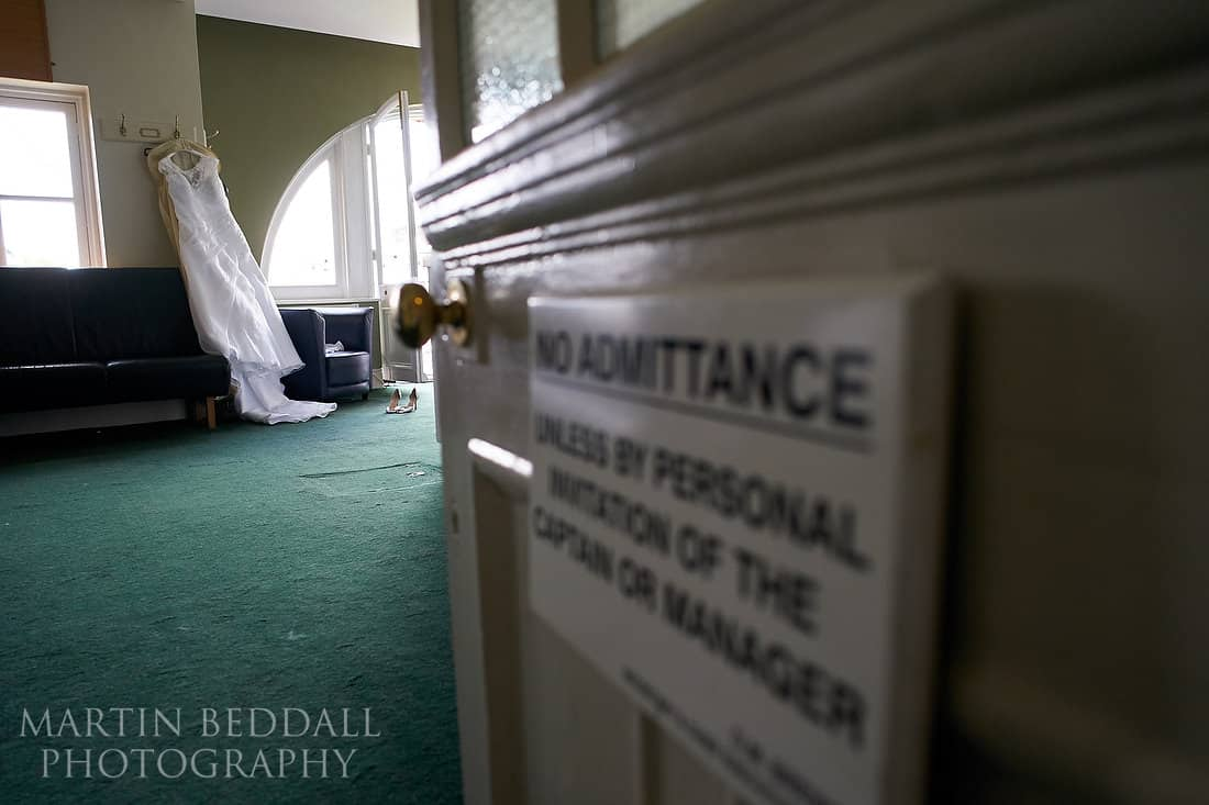 Wedding dress hanging in the England dressing room at Lord's