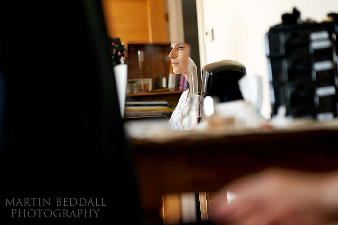 Bride reflected in the makeup mirror