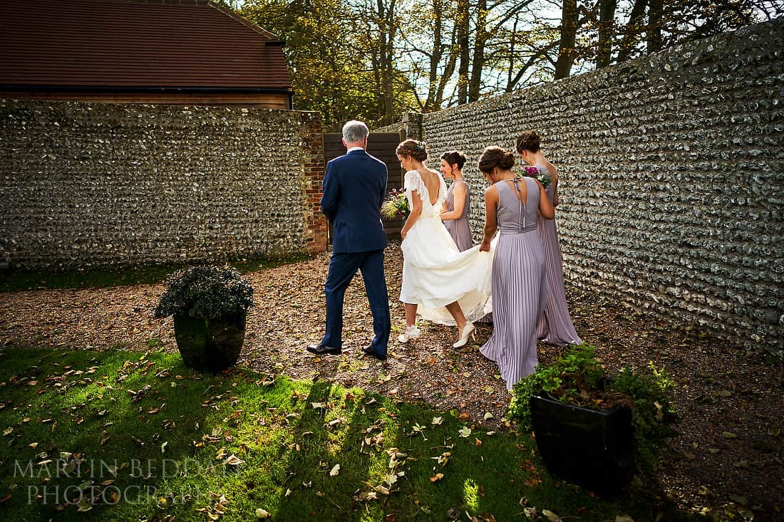 Walking to the ceremony at Cissbury Barns
