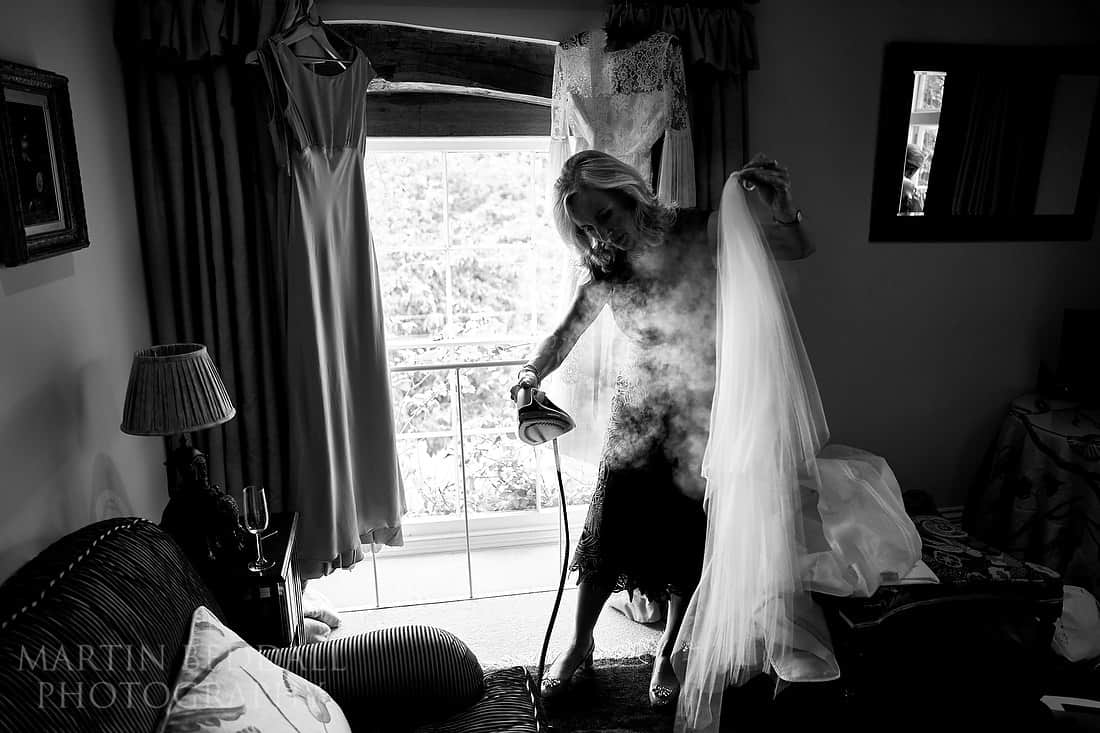 Steaming the bride's veil