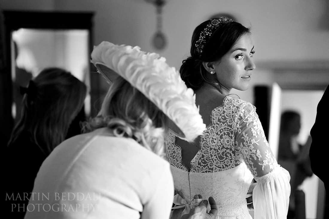 Tying up the wedding dress