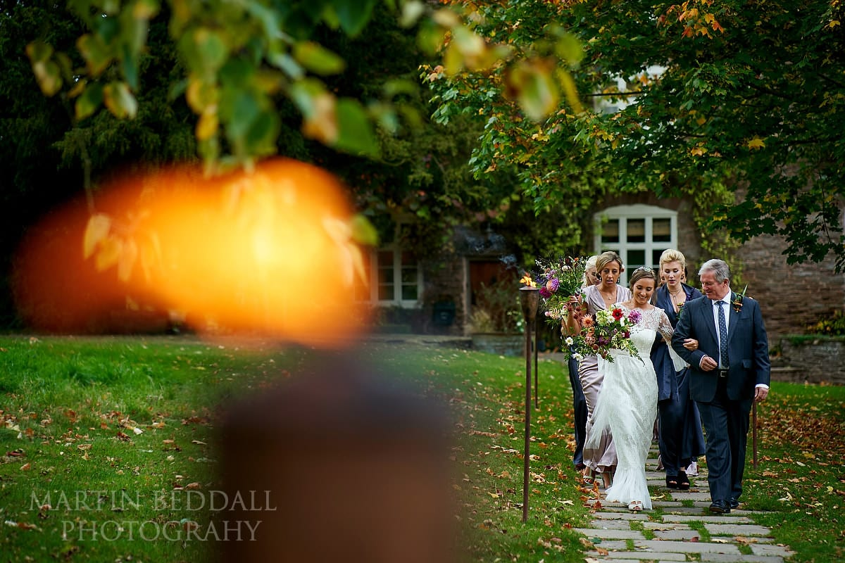 Briemakes her way to the ceremony barn at Dewsall Court near Hereford