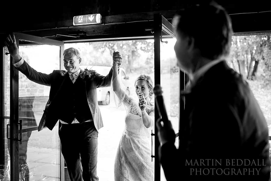 Bride and groom announced into the Wainhouse