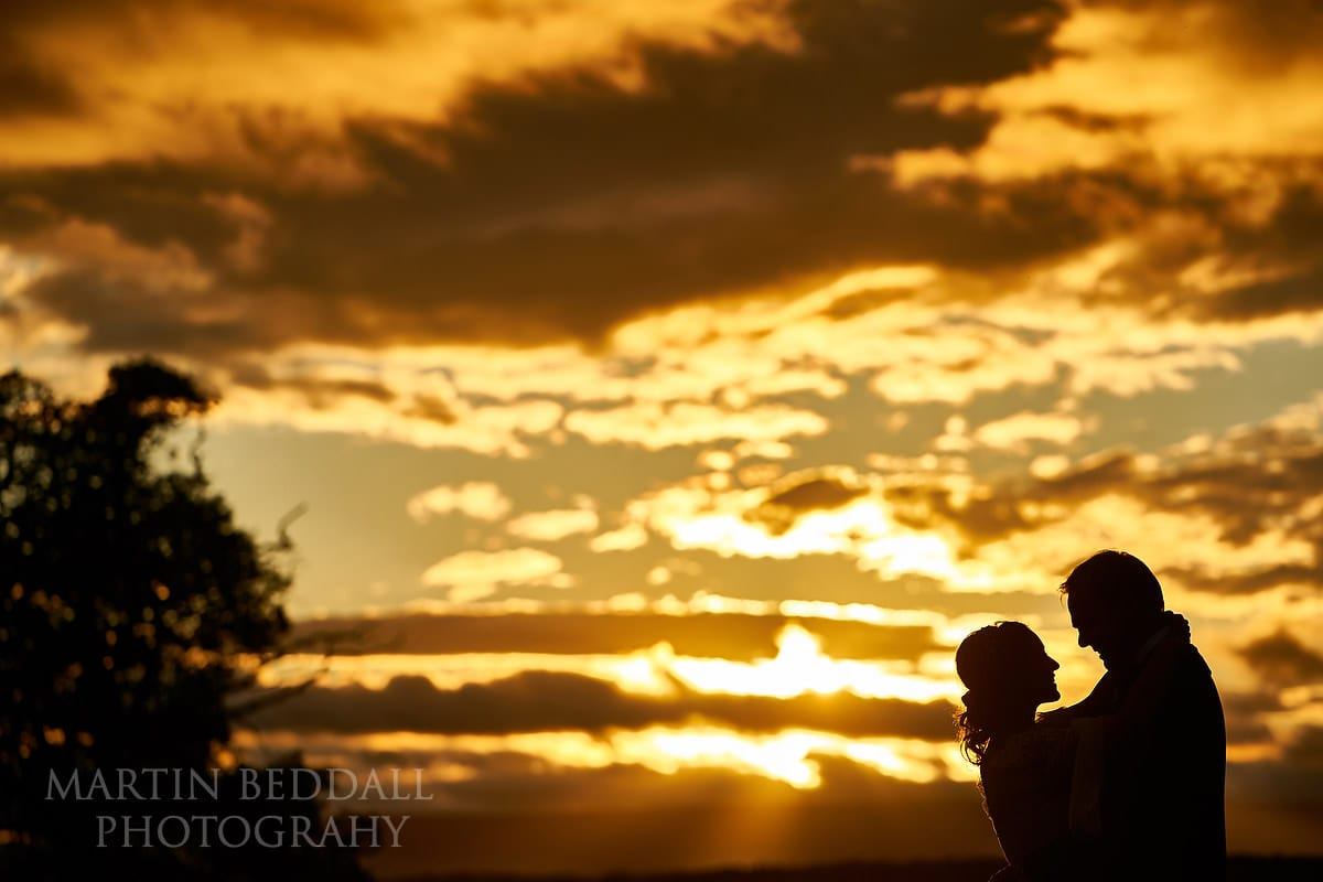 Sunset portrait at Hereford wedding venue Dewsall Court