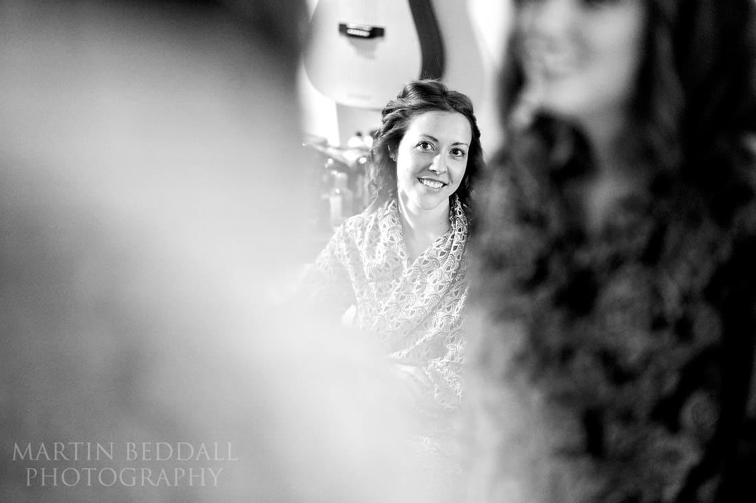 Bride watchs in the mirror