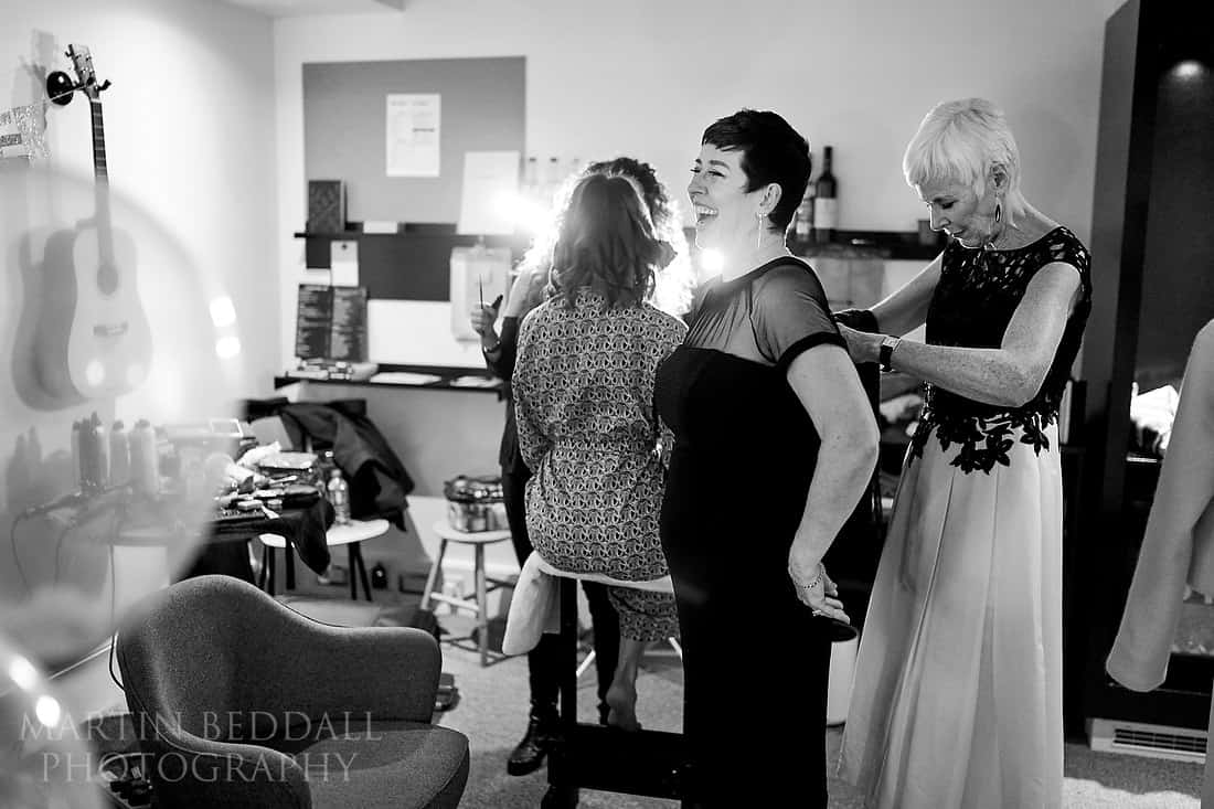 The two mums help each other get ready