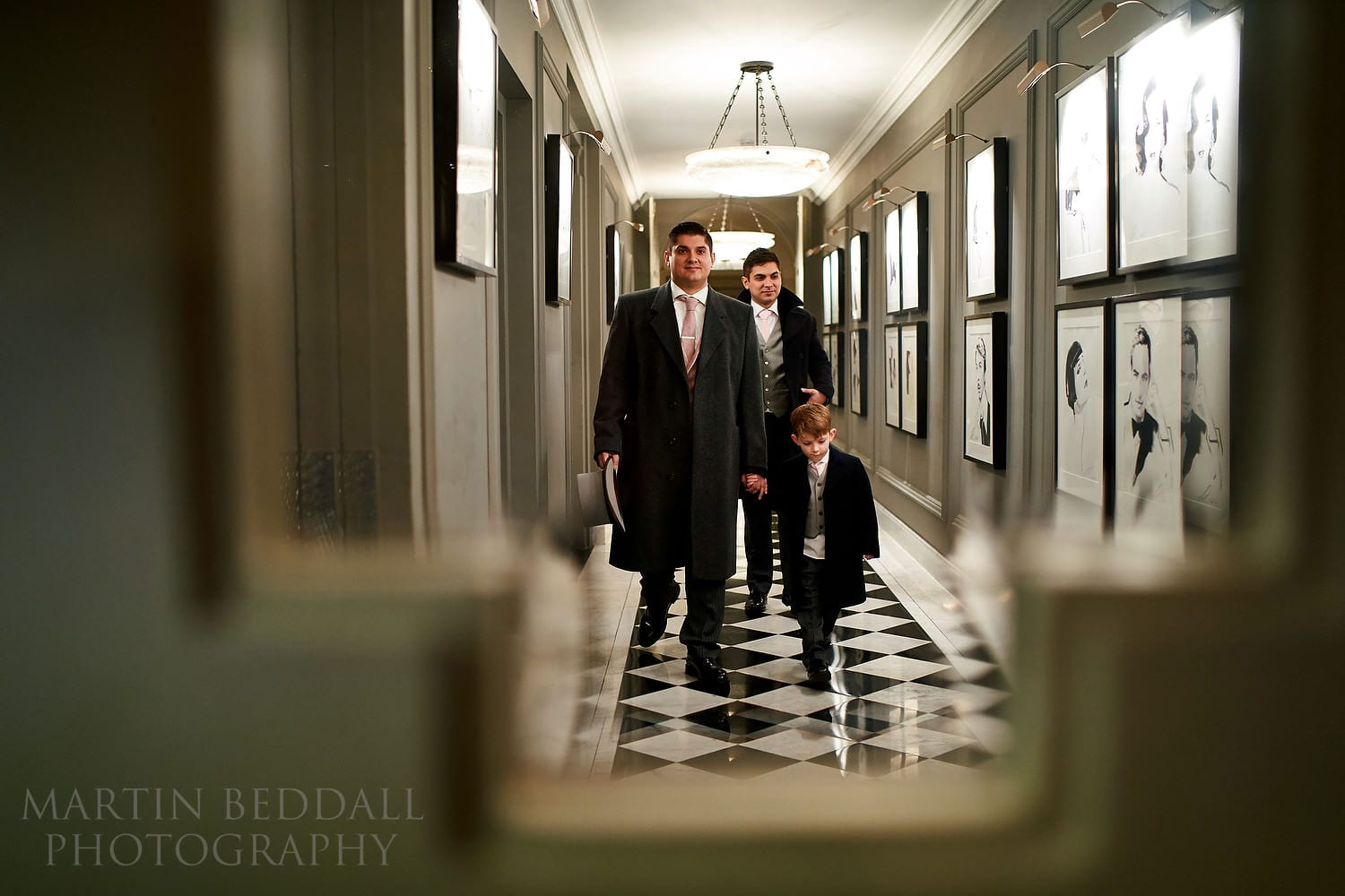 The groom, his son and his brother arrive at Claridges for the wedding ceremony
