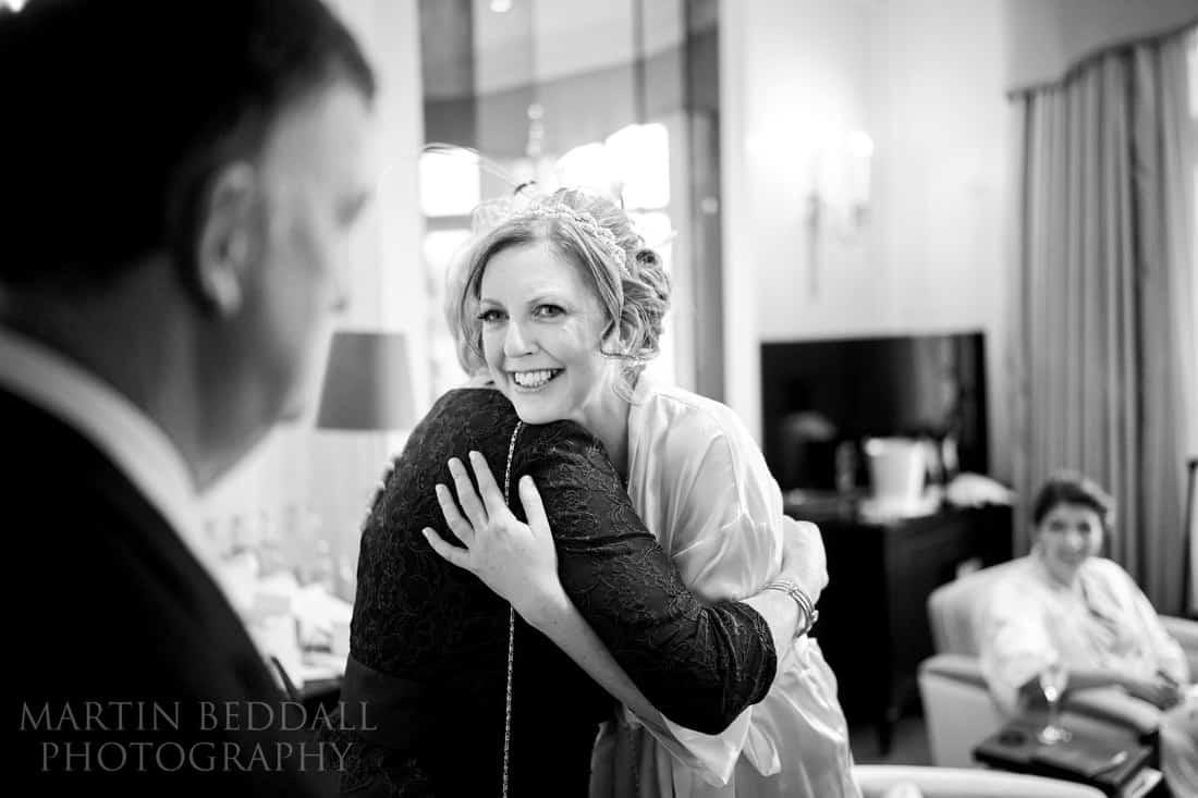 Bride hugs her tearful mother