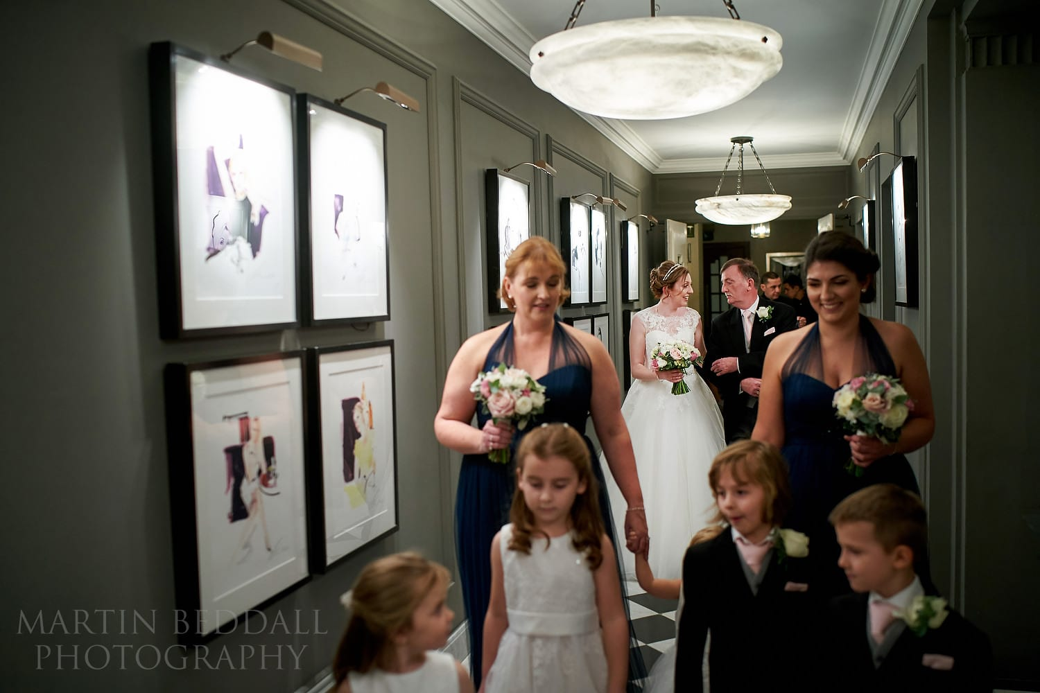 Bridal party heading to the ceremony at Claridges wedding