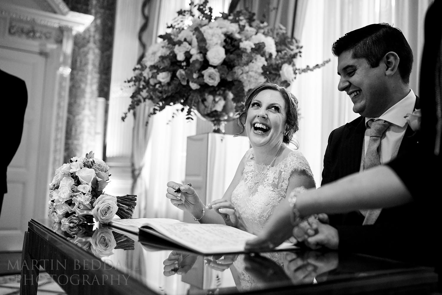 Signing the register at Claridges wedding