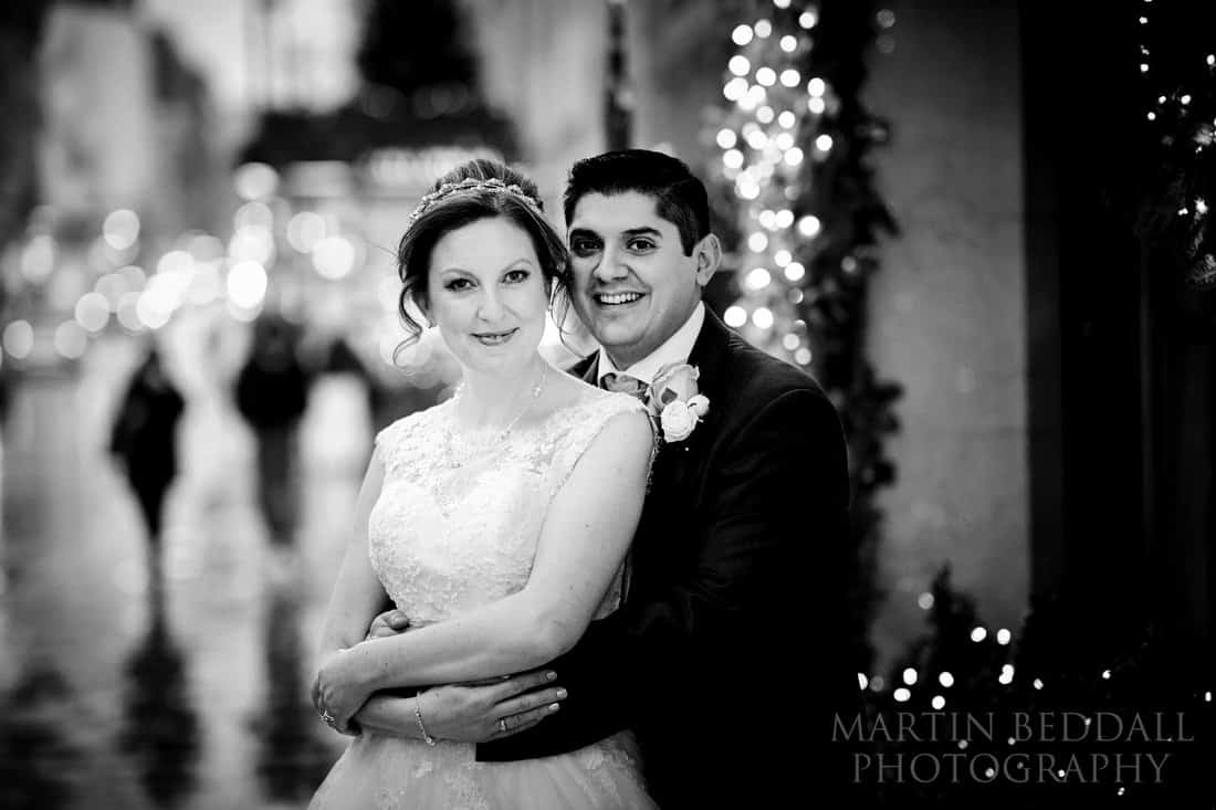 Bride and groom portrait in the rain outside Claridges