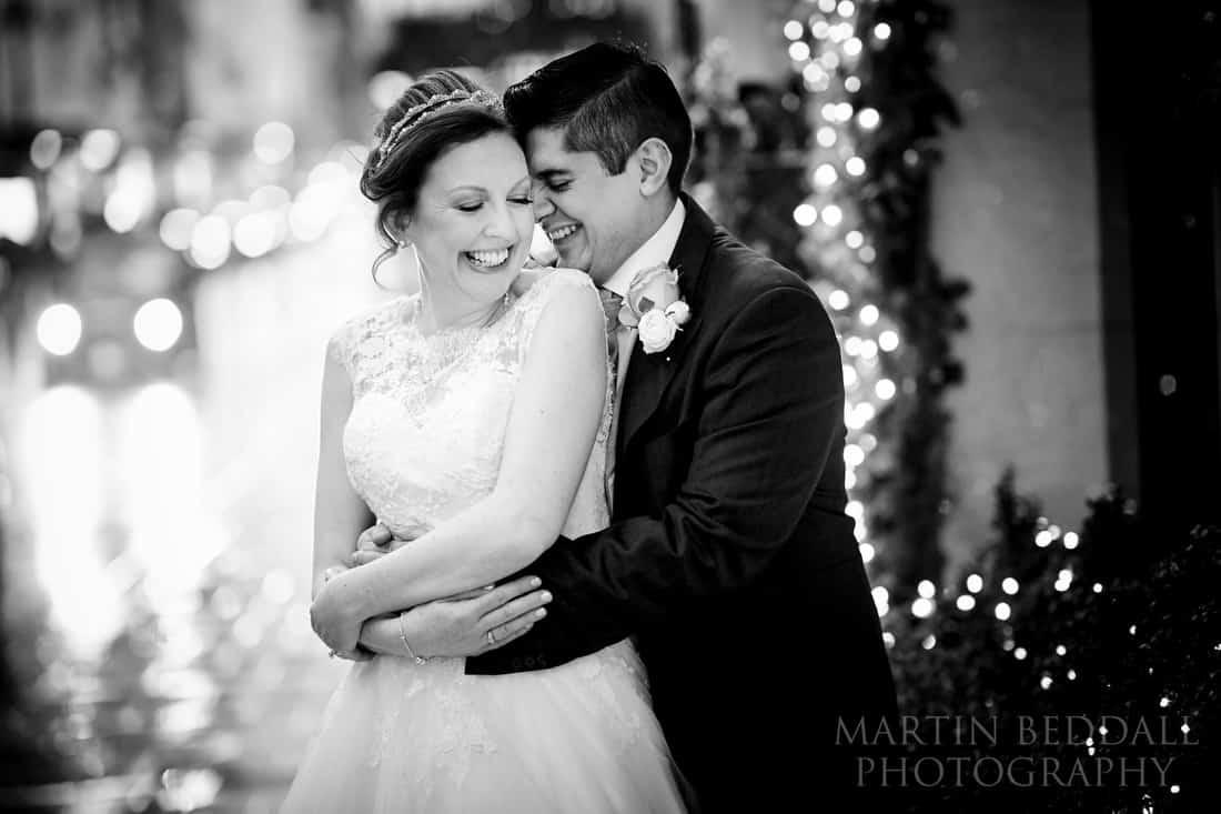 Bride and groom portrait in the rain outside Claridges