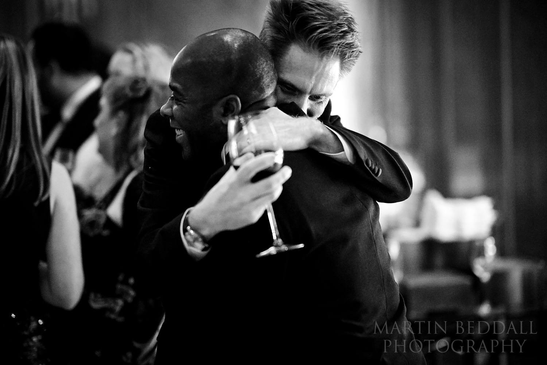 Guests hug