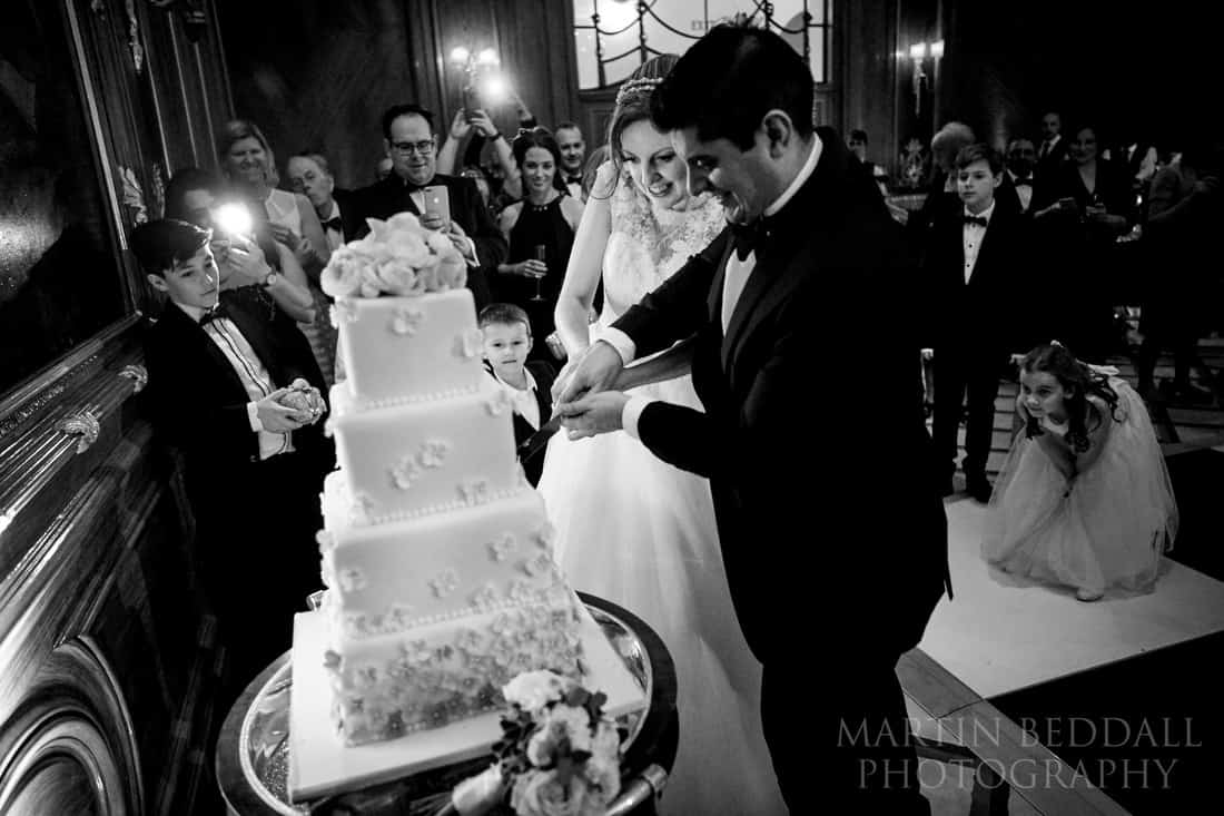 Cutting the wedding cake at Claridges
