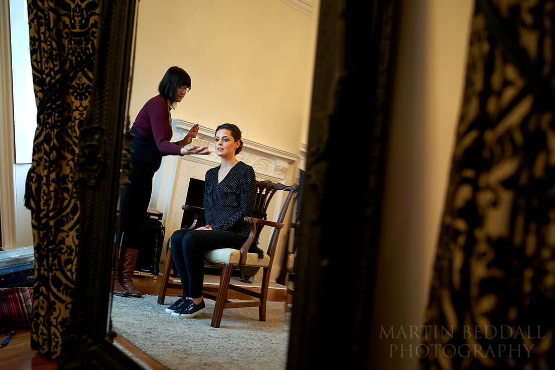 Bride checks her makeup