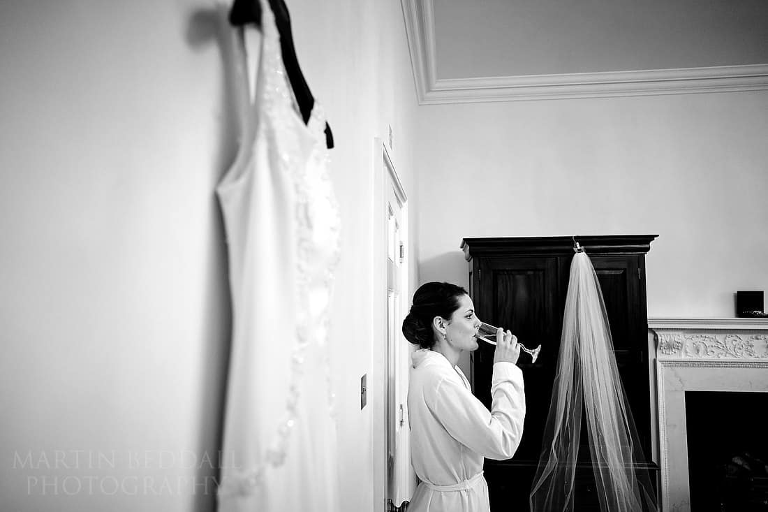 Bride drinks some champagne