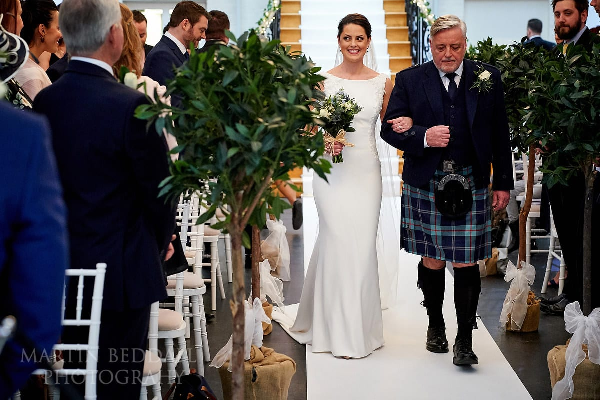 Bride walks down the aisle with her father at Botleys