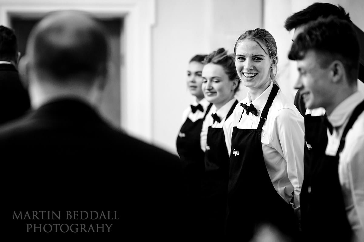 Bijou staff smiling at wedding guests at Botleys