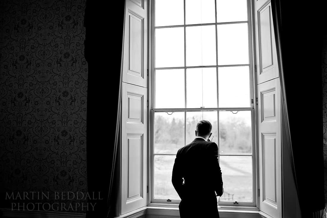 Groom looks out of the window