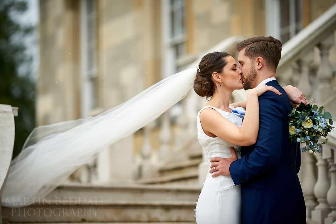 Bride and groom kiss at Botleys