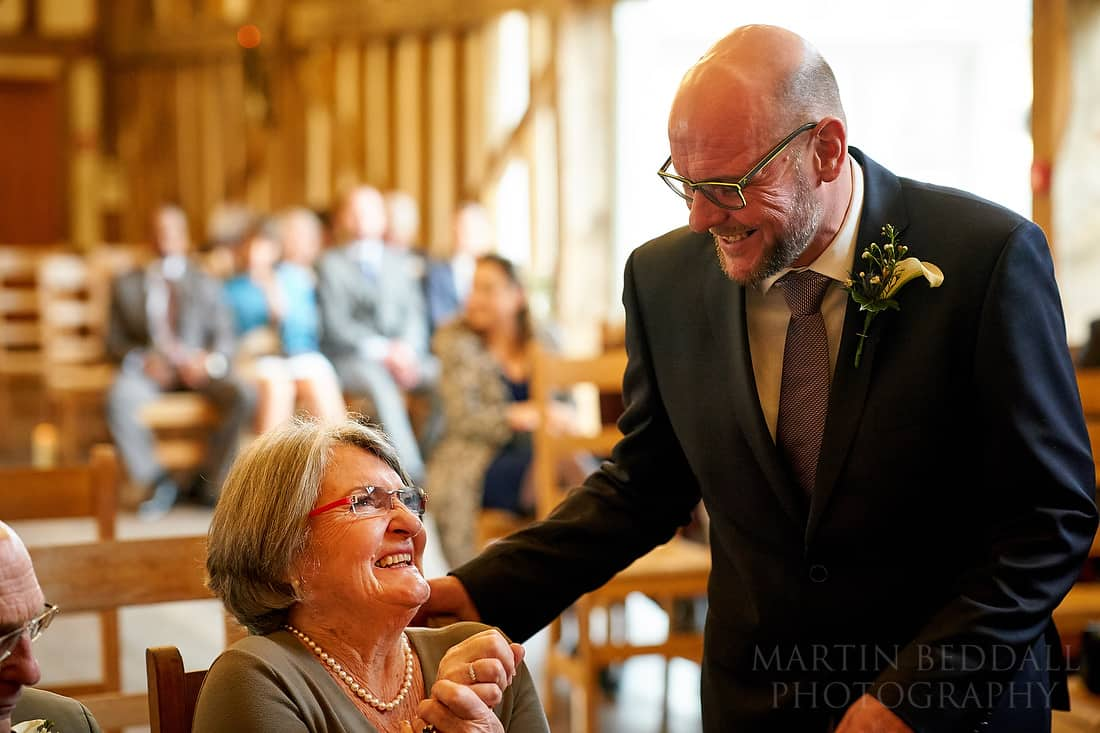 Groom laughing with his mother