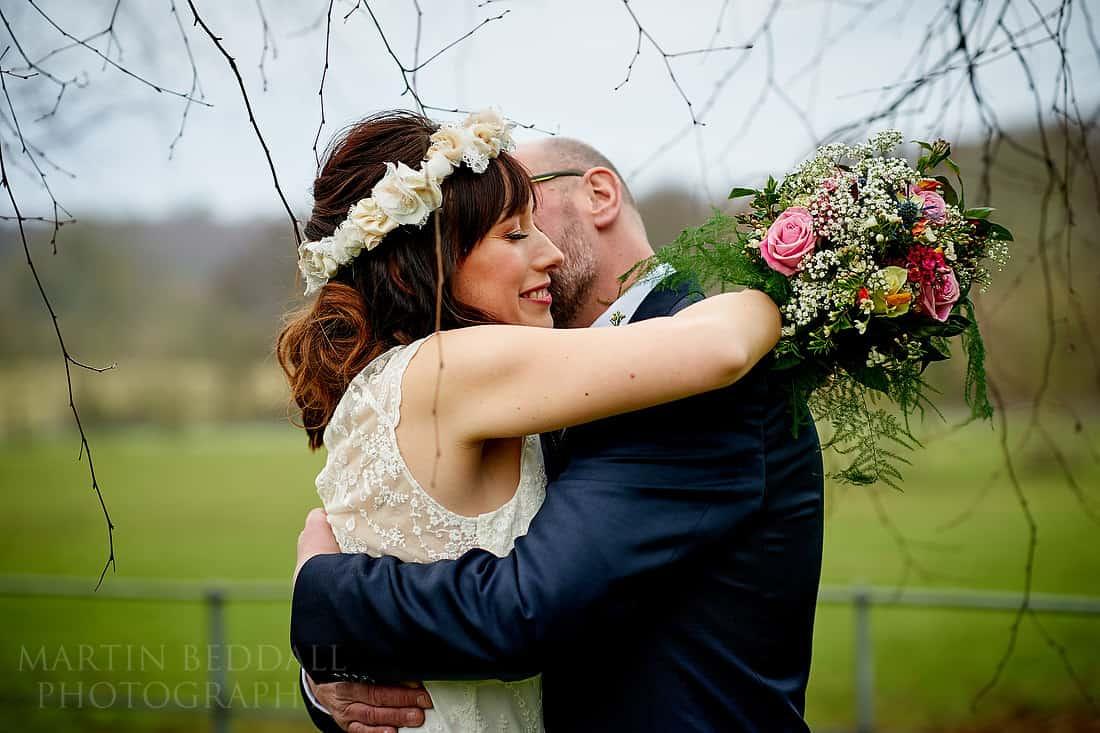 Bride and groom hug at Gate St