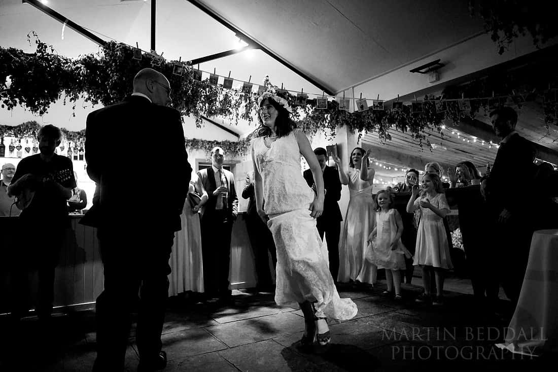 Bride and groom dance by the bar in the Pheasantry