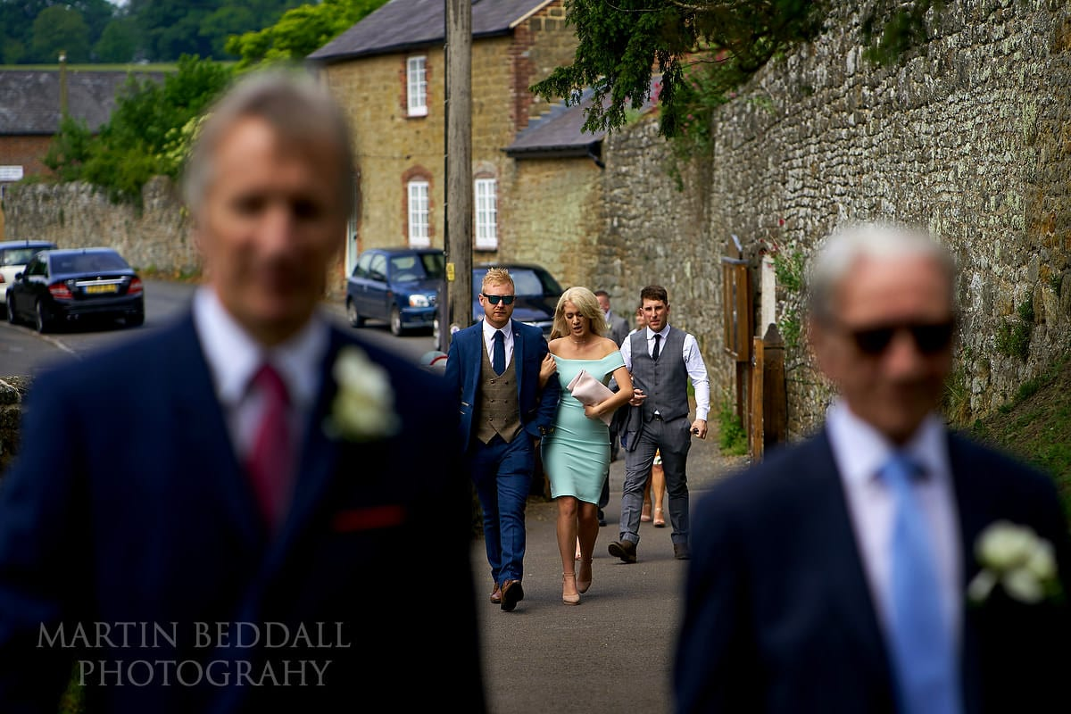 Wedding guests arrive at All Hallows church in Tillington