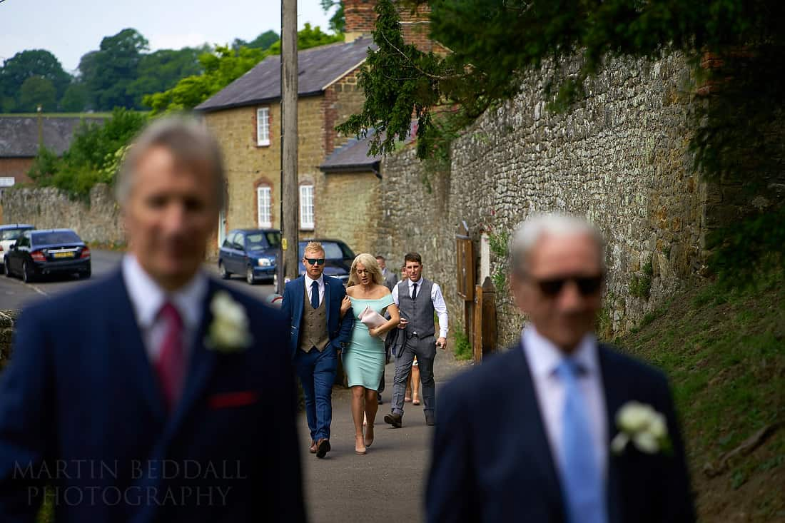 wedding guests head to the church