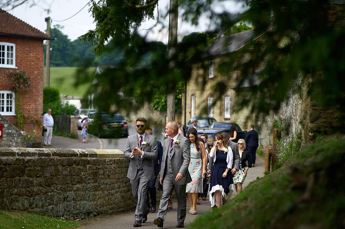 groom and his son head to the church