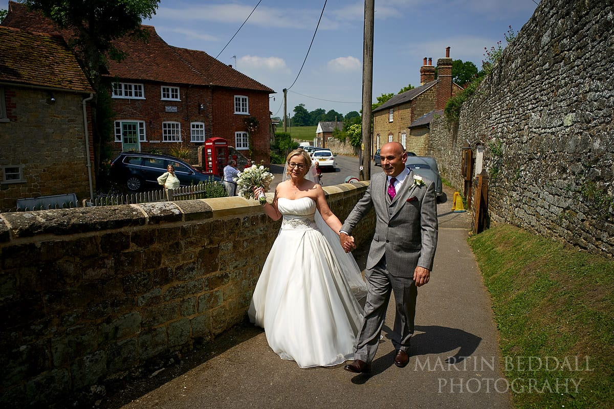 Bride arrives with her brother at All Hallows church in Tillington
