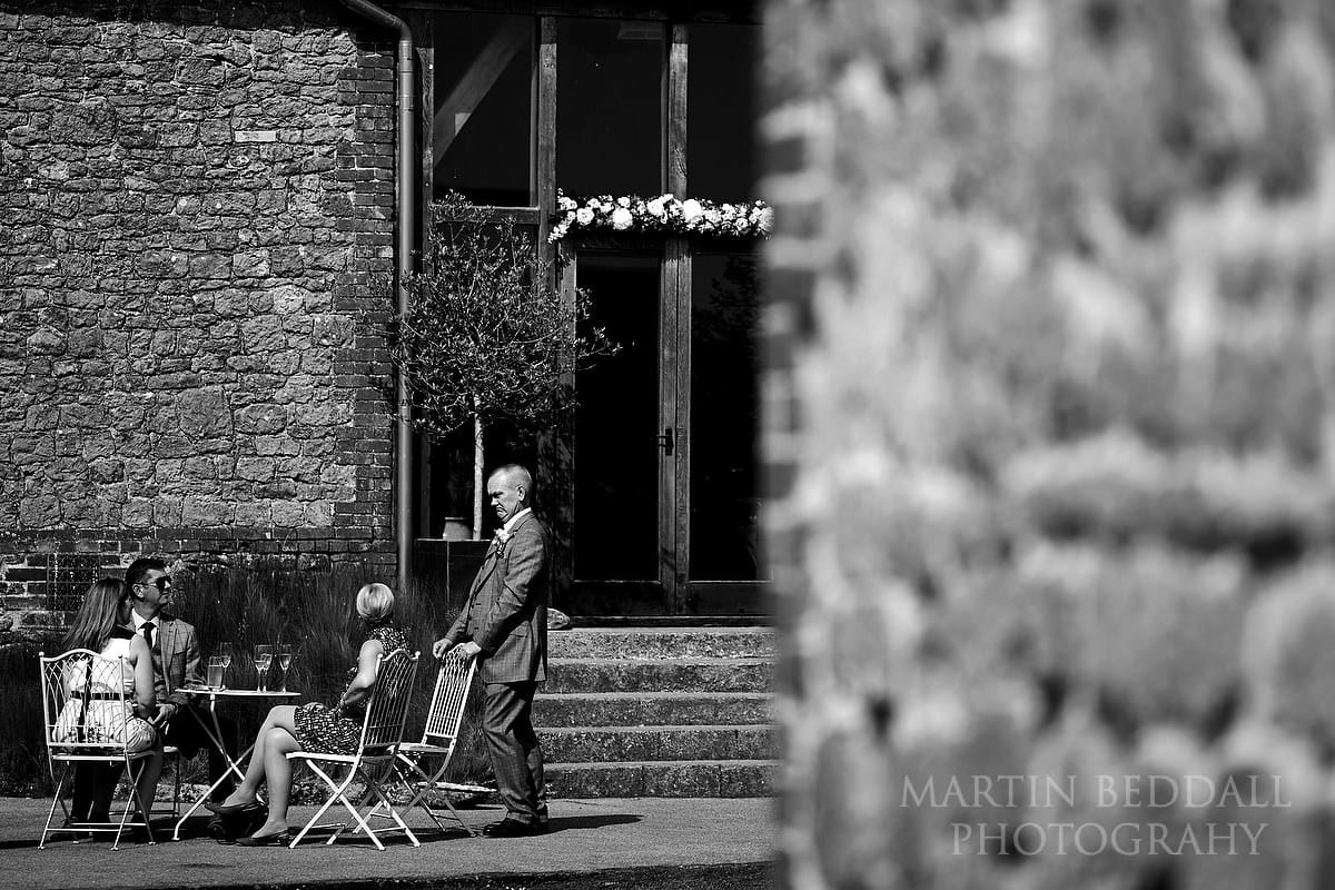 Groom chats with guests at Grittenham Barn