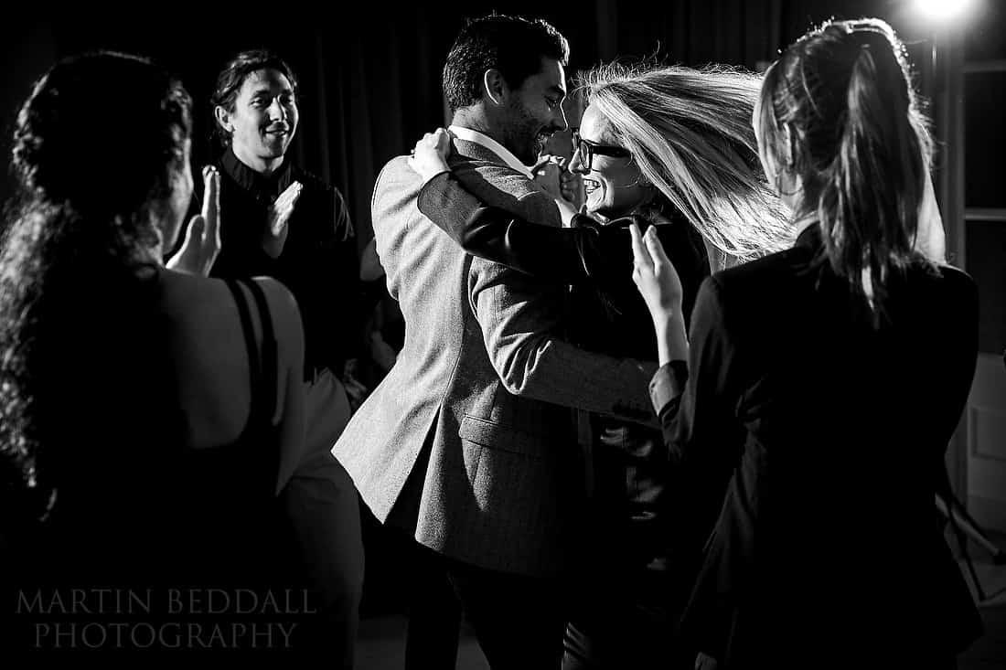 Bride dances with a guest at the ceilidh