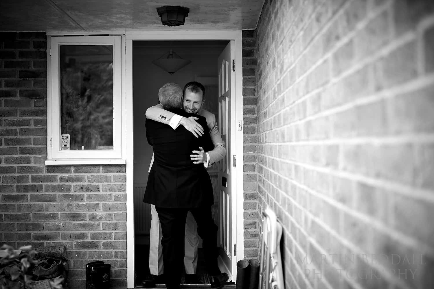 Groom hugs his father-in-law