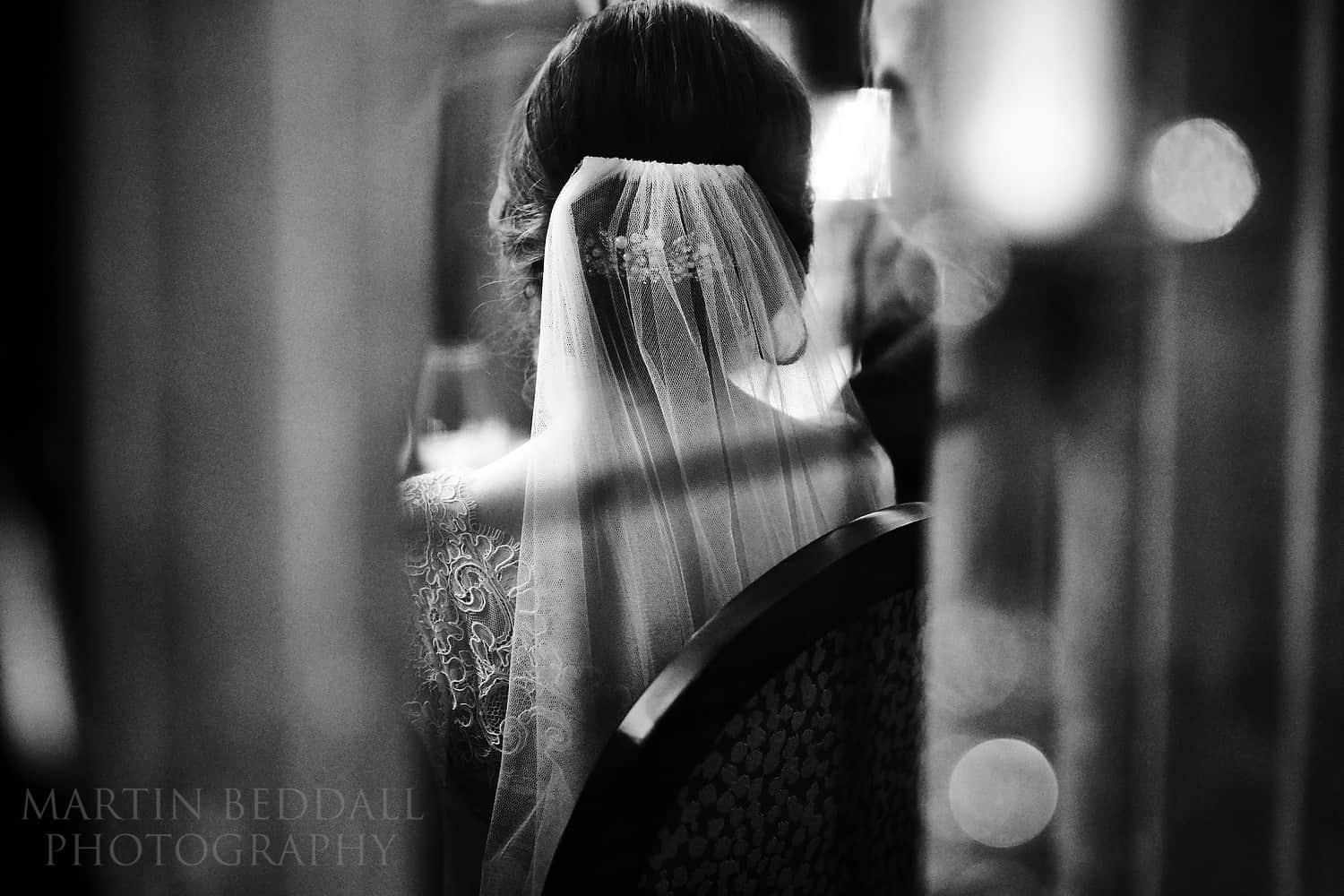 Detail of the bride shot through a window using a Sigma 105mm f1.4 lens on a Sony A9