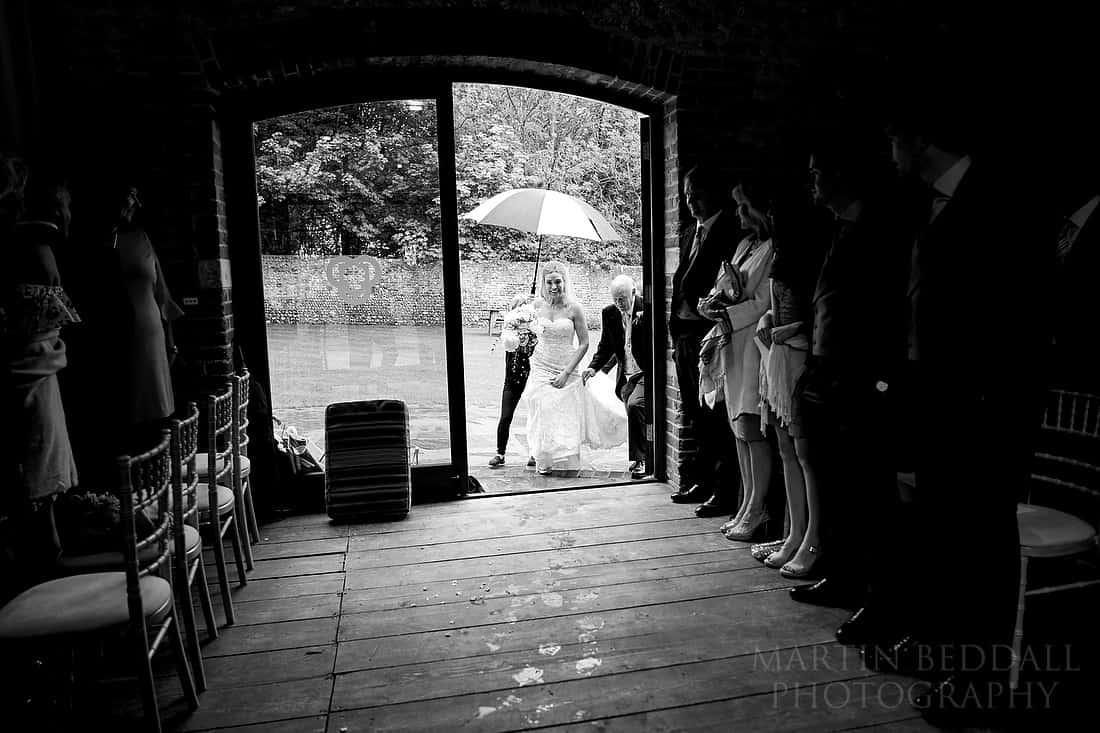 Bride enters the ceremony barn