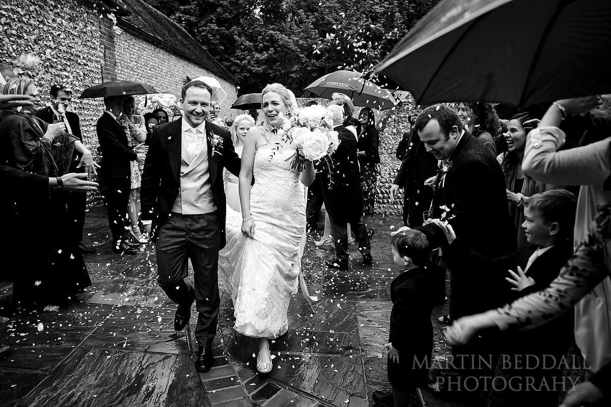 Confetti at Wet wedding at Cissbury Barns