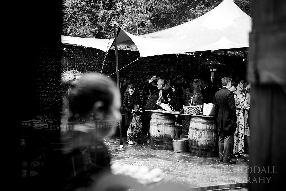 Wet wedding reception at Cissbury Barns