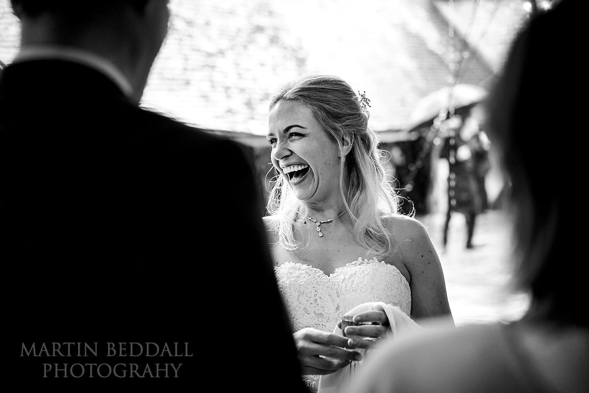 Bride laughs with the guests
