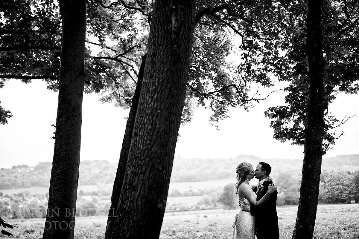 Couple portrait in the rain at Cissbury Barns