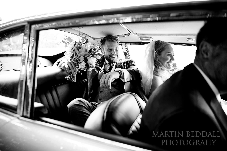 Groom squeezes into Aston Martin