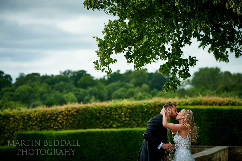 Bride and groom kiss at Buckhurst Park